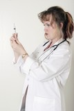 lady doctor prepping up a syringe poster