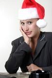 woman wearing santa hat at work poster