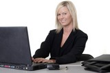 attractive woman typing on laptop poster