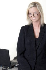smart looking smiling business woman wearing eye g