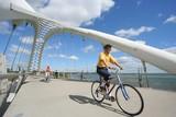 cyclist on bridge poster