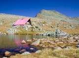 cabin and a glacial lake up in national park pirin poster