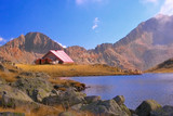 mountain refuge next to a glacial lake in national poster