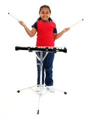 young girl playing xylophone