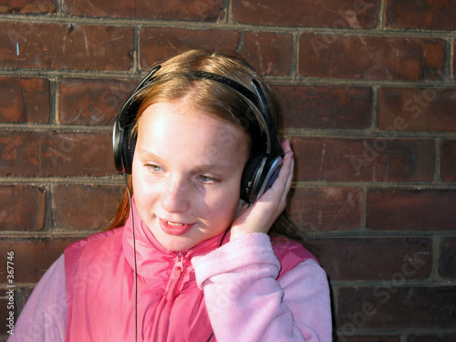 poster of portrait of a girl with headphones