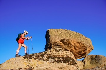 female climbing a cliff