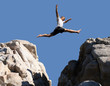 Leinwanddruck Bild - boy jumping over the mountains