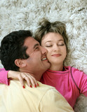 sweet young couple lying on the rug poster
