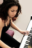beautiful middle eastern girl playing piano