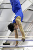 young gymnast competing on parallel bars poster