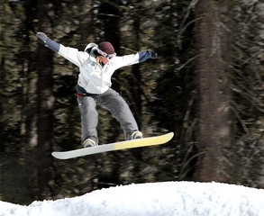 girl jumping on a snowboard