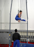gymnast competing on rings poster