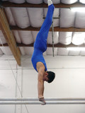 gymnast competing on parallel bars poster
