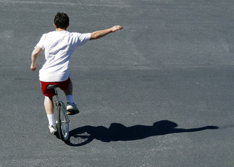 boy on a unicycle