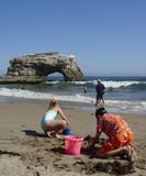 kids playing on the beach at santa cruz, ca poster