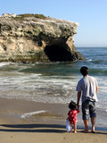 father and daughter looking at the ocean poster