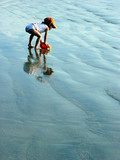 kid playing on the beach poster