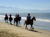 horseback riders at the beach poster