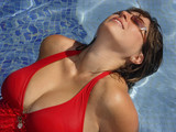 woman in the red swimming suit poster