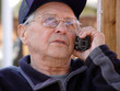 an old man talking on the phone