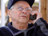 an old man talking on the phone poster