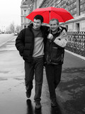 2 male friends walking on the street of paris poster
