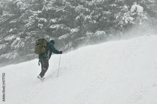 poster of climber going for the top in a snow storm