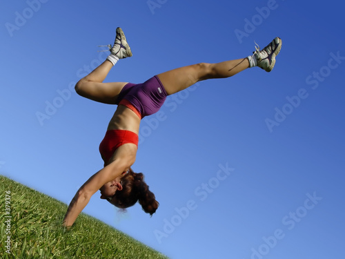 girl exercising outdoors on the grass