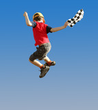 boy with a checked flag jumping in the air poster