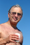 mature man  at the beach poster