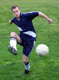 soccer player hitting a ball poster