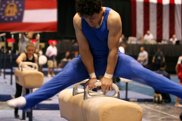 gymnast competing on pommel