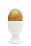 golden egg in an egg cup poster