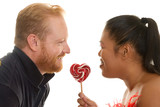 two people share a candy poster