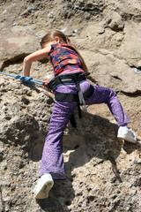 girl in purple climbing