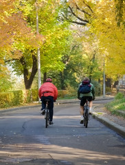 autumn bicyclists