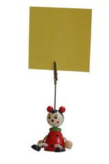 ladybug holding up a yellow note