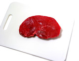 raw steak on cutting board poster