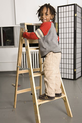 little boy on a ladder