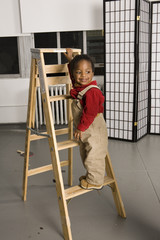 smiling baby on a ladder