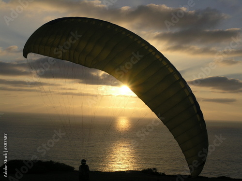 hang glider in sunset