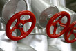 red valves with stainless steel pipes