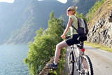 active woman on bike is having break poster