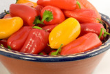a bowl of  colorful sweet peppers poster