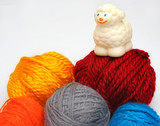 sheep over balls of yarn