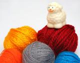 sheep over balls of yarn poster