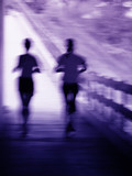 artistic blue and purple blur of a running couple poster