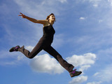 young woman jumping high in the air poster