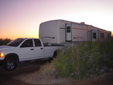 fifth wheel trailer at sunset poster