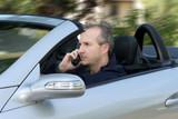 man driving a car poster
